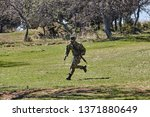armed soldier ready for battle. ...   Shutterstock . vector #1371880649