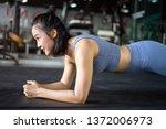 woman doing plank exercise on... | Shutterstock . vector #1372006973