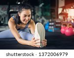young asian woman in gym... | Shutterstock . vector #1372006979