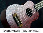 mahogany ukulele close up on... | Shutterstock . vector #1372046063