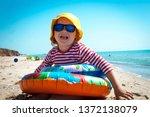 happy little girl in sunglasses ... | Shutterstock . vector #1372138079