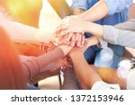 group of people stacking hands... | Shutterstock . vector #1372153946