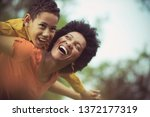 on mother wings. mother and son ... | Shutterstock . vector #1372177319