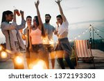 carefree group of happy friends ... | Shutterstock . vector #1372193303