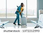happy african american man with ... | Shutterstock . vector #1372212593