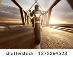 motorcycle on a bridge at sunset | Shutterstock . vector #1372264523