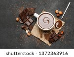 cup of hot chocolate and pieces ...   Shutterstock . vector #1372363916