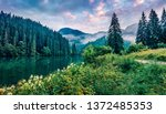 dramatic morning scene of lacu... | Shutterstock . vector #1372485353