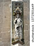 Small photo of Sculpture of Saint Luke the Evangelist, monumental standing figure on the outer side of the flying buttress pier at medieval Gothic Black Church in Brasov city. Transylvania, Romania