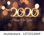 2020 new year shiny vector... | Shutterstock .eps vector #1372513469