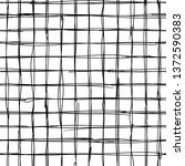 hand drawn black grid on a... | Shutterstock .eps vector #1372590383