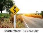Winding Road Sign In The Fores...