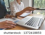 business team brainstorming and ... | Shutterstock . vector #1372618853