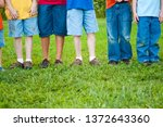 boys with grass stained pants... | Shutterstock . vector #1372643360