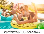 group of friends at a poolside...   Shutterstock . vector #1372655639