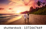 young happy lovers on beach.... | Shutterstock . vector #1372667669