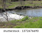 Small photo of Independence, Missouri / USA - April 13 2019: Water Flowing over Erosion Control Letdown Structure in the Little Blue River