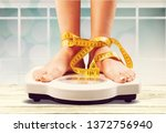 woman on scales and measuring... | Shutterstock . vector #1372756940