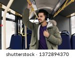 young man listening to music... | Shutterstock . vector #1372894370
