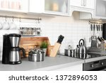 Stock photo different appliances clean dishes and utensils on kitchen counter 1372896053