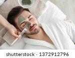cosmetologist applying mask on... | Shutterstock . vector #1372912796