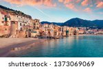Attractive evening cityscape of Cefalu town. Amazing sunset on Mediterranean sea, Sicily, Italy, Europe. Traveling concept background.
