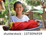asian boy bring clothes basket... | Shutterstock . vector #1373096939