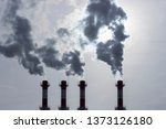 silhouettes of pipes emitting... | Shutterstock . vector #1373126180