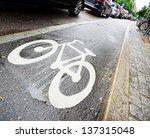 Bike lane and car queue - stock photo