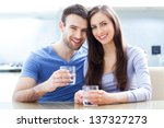couple with glasses of water | Shutterstock . vector #137327273