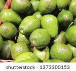 fresh avocado on the market.... | Shutterstock . vector #1373300153