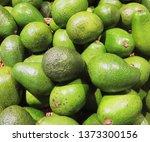 fresh avocado on the market.... | Shutterstock . vector #1373300156