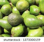 fresh avocado on the market.... | Shutterstock . vector #1373300159