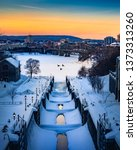 OTTAWA, CANADA - Rideau Canal Locks with beautiful winter sunset and birds flying by. Blue, yellow and orange sky with lots of snow on canal waterway. Canadian winter scene. Ottawa, Ontario, Canada