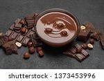 glass bowl of chocolate cream...   Shutterstock . vector #1373453996