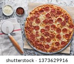 large pepperoni pizza on marble ... | Shutterstock . vector #1373629916