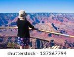 young girl overlooking in grand ... | Shutterstock . vector #137367794