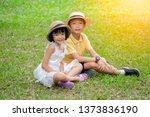 Kid Brother Sister Sitting Park - Fine Art prints