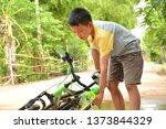 asian boy an accident bike... | Shutterstock . vector #1373844329