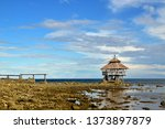 rest house by the sea with blue ... | Shutterstock . vector #1373897879