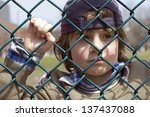 Sad Little Boy Behind A Fence