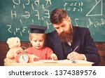 busy kid studying at school.... | Shutterstock . vector #1374389576