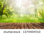 wooden table and spring forest... | Shutterstock . vector #1374404510