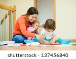 happy mother and her children... | Shutterstock . vector #137456840