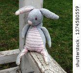 Stock photo macro photo old vintage toy rabbit fabric soft gray bunny rabbit with long ears children s toy 1374580559