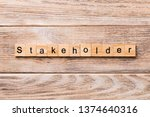 Small photo of Stakeholder word written on wood block. Stakeholder text on wooden table for your desing, concept.