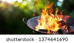 barbecue grill with fire on... | Shutterstock . vector #1374641690