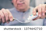 old man brushing teeth in front ... | Shutterstock . vector #1374642710