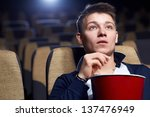 young man in a movie theater   Shutterstock . vector #137476949