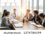 businesspeople discussing... | Shutterstock . vector #1374784199